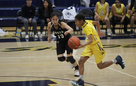 Freshman Janna Holley playing against Mira Costa High School on Nov. 28