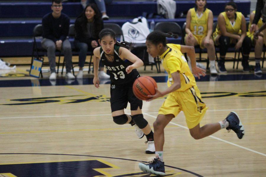 Freshman Janna Holley playing against Mira Costa High School on Nov. 28