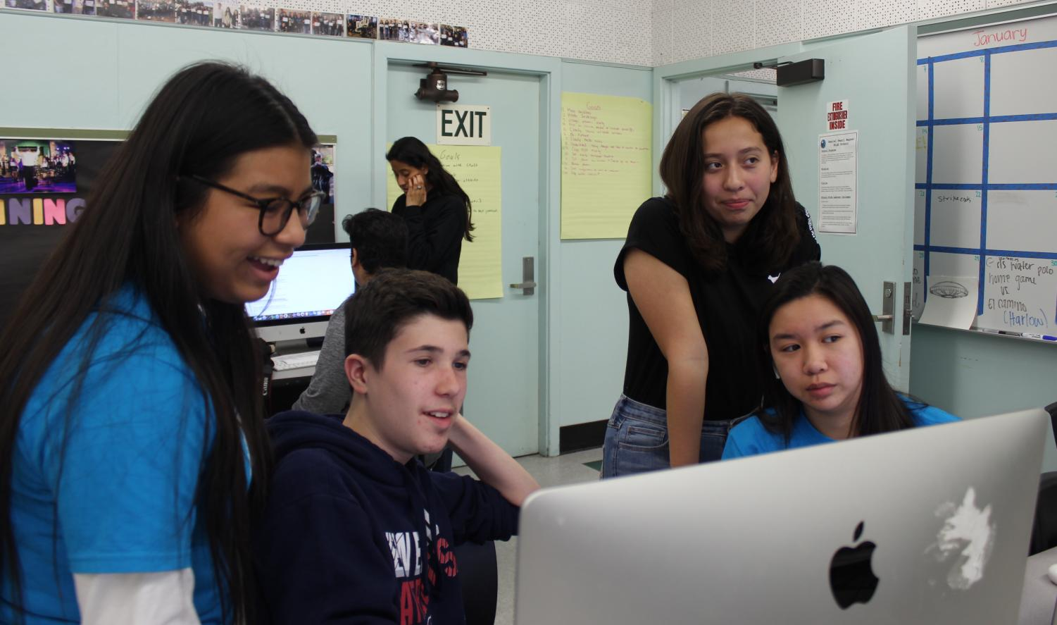 Staff Writers Mahali Sanchez, Casey Wanatick, Itzel Luna and Alliana Samonte look over stories.