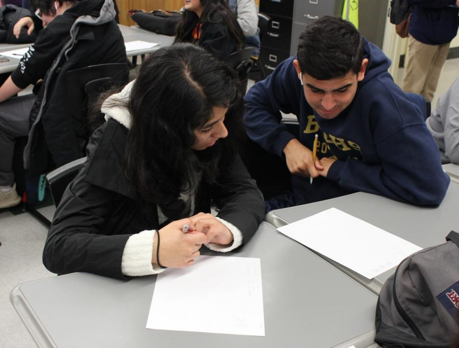 Senior Vanessa Rizo and Ben Sanchez participate in a drawing activity during class on Jan. 14.