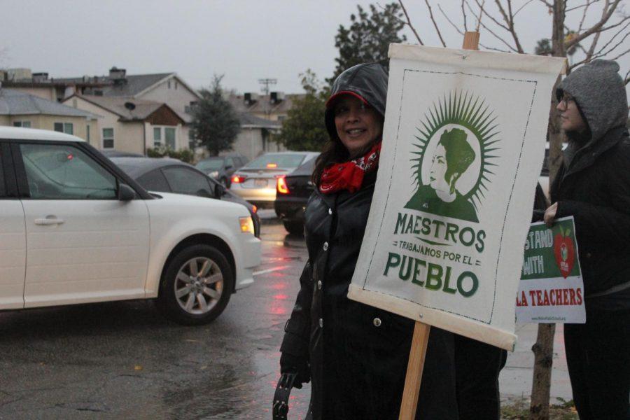 Spanish Teacher Glenda Hurtado rallies up car hornks outside Daniel Pearl Magnet High School on Jan. 14.
