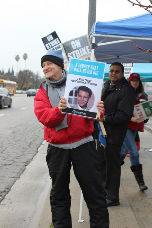 English teacher Ron Baer continued to picket along with other teachers and staffs during the third day of striking on Jan. 16.