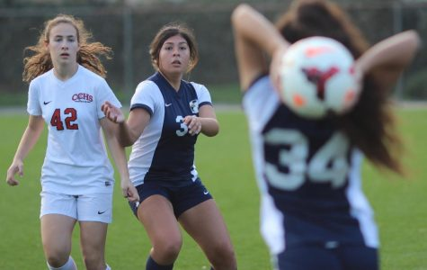 Junior Rosalinda Nava prepares to receive the ball during a varsity soccer game against Cleveland Charter High School on Jan. 30.