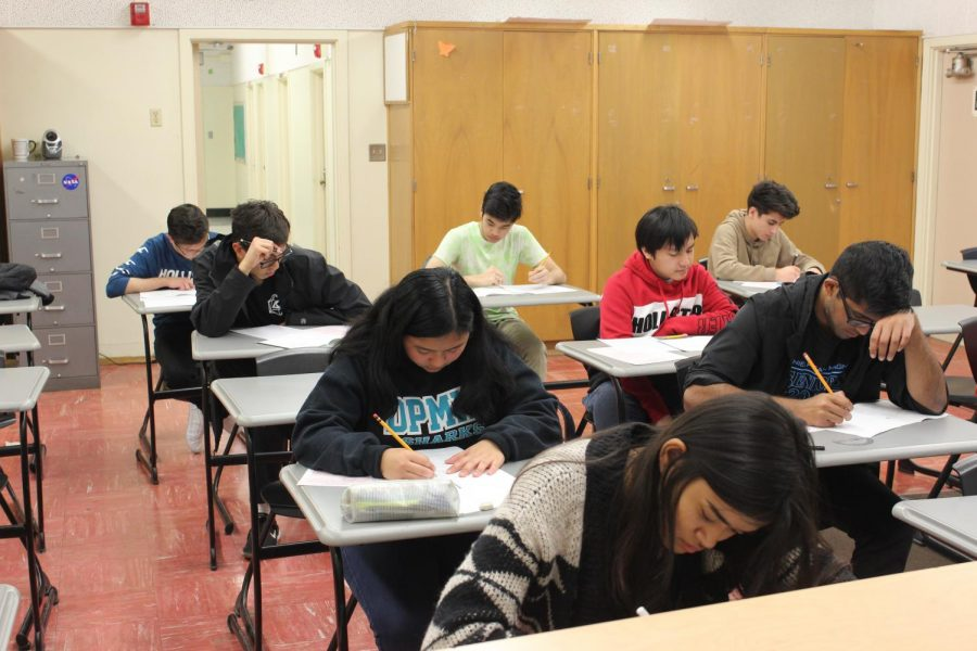 Students+of+various+grades+participate+focus+on+their+exam+during+the+American+Math+Contest.