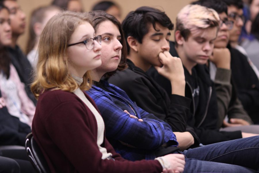Sophomores Susanna Ness and Stephanie Pynes listen to the ninth and tenth grade assembly assembly on Jan. 30.