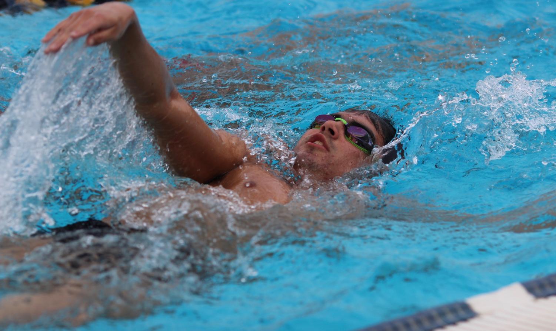 Senior Ben Sanchez performs his backstroke during BCCHS swim practice on Feb. 27.