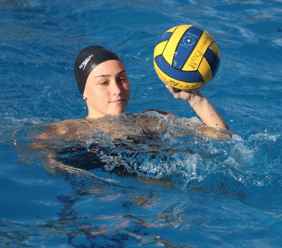 Sophomore Petra Vass left wing gets ready to pass the water polo ball ti teammate during practice on Feb. 5.