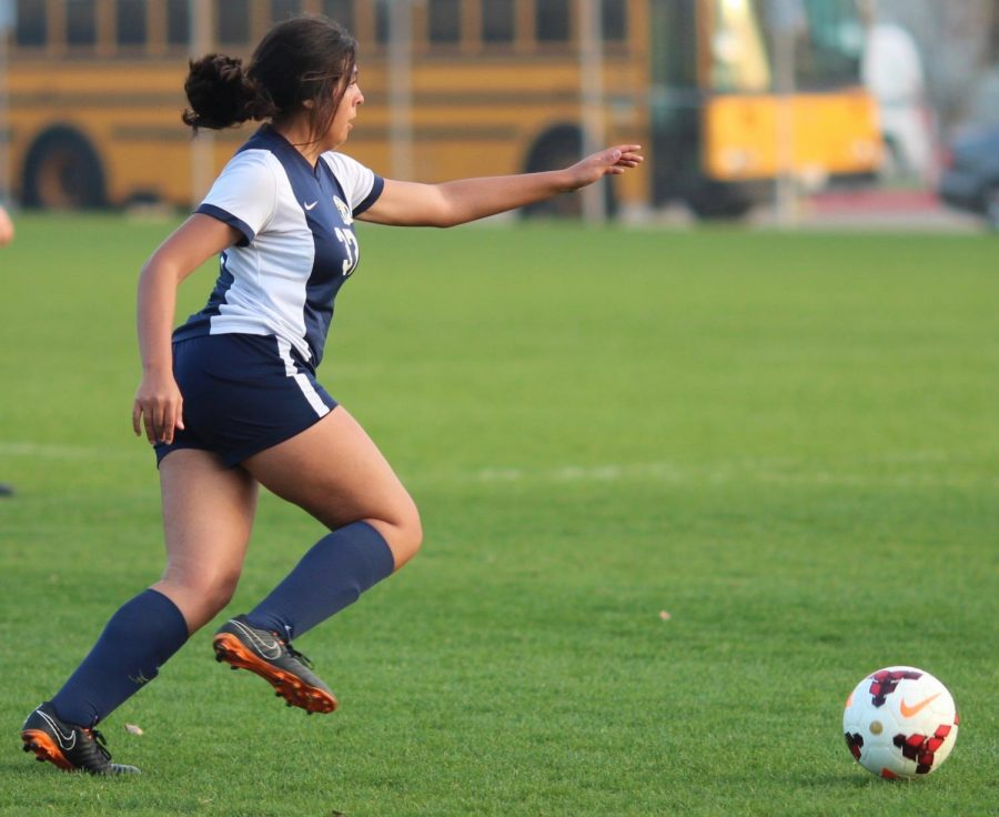 Junior Rosalinda Nava runs toward the ball during a varsity soccer game against Cleveland Charter High School on Jan. 30.