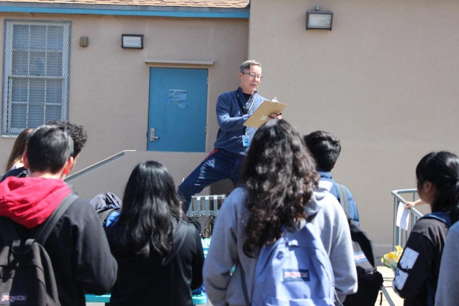 Higgins Adviser Mark Middlebrook announces activity directions to students on March 22.
