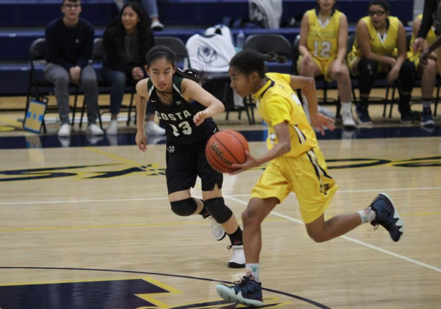Freshman+Janna+Holley+dribbles+the+ball+during+a+game+against+Mira+Costa+High+School+on+Nov.+28.