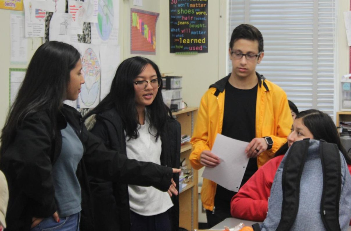 President Astrid Cabrera, Treasurer Karina Mara and Vice President Michael Chidbachian discuss National Honor Society volunteering opportunities on Feb. 20.