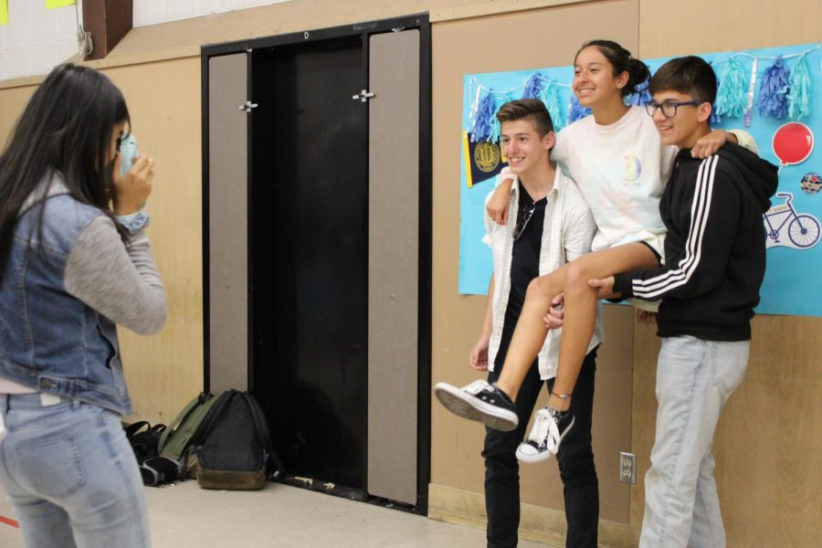 Senior Christine Valenzuela takes students' photos on a Polaroid camera during lunch.