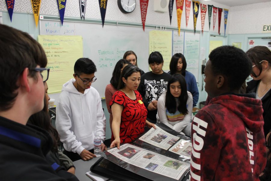 Los Angeles Times reporter Esmeralda Bermudez shows students her stories that have made it to the front page on March 1.