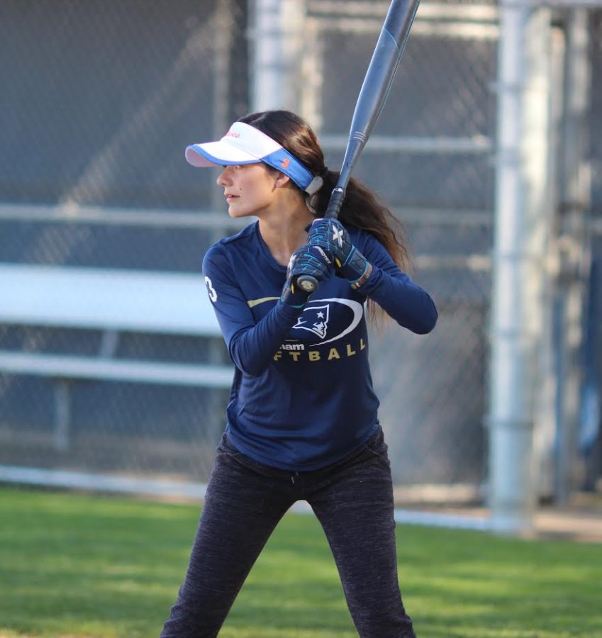 Senior+varsity+player+Genevieve+Avalos+practices+hitting+the+ball+at+softball+practice+on+March+14.