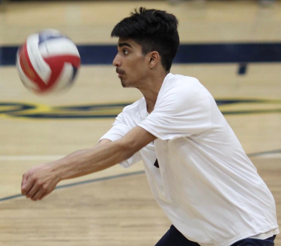 Sophomore Om Patel hits the ball during a game against Taft Charter High School on April 5.