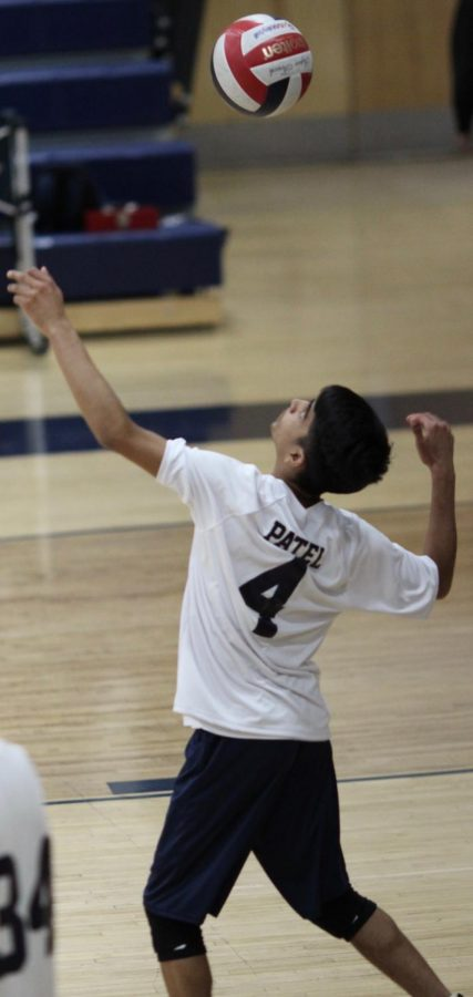 Sophomore Om Patel serves the ball during a game against Taft Charter High School on April 5.