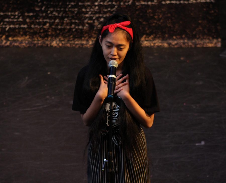 """During the Get Lit Classic Slam performance junior Andi Mendoza performs her response poem """"Poor little Princess"""" on April 25."""