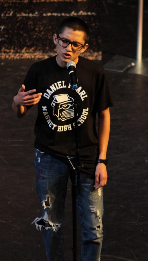 """Junior Jason Echeverria recites his poem """"No soy corbarde Mama"""" during the performance on April 25."""