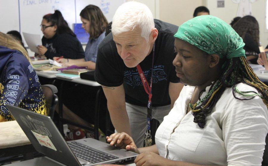 English teacher Ron Baer assists sophomore Sydnee Blueford during third period on April 11.