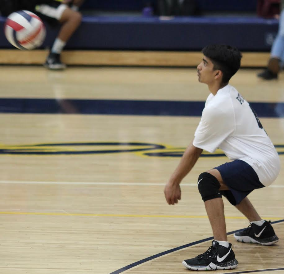 Sophomore Om Patel hits the volleyball during a game against Taft Charter High School on April 5.