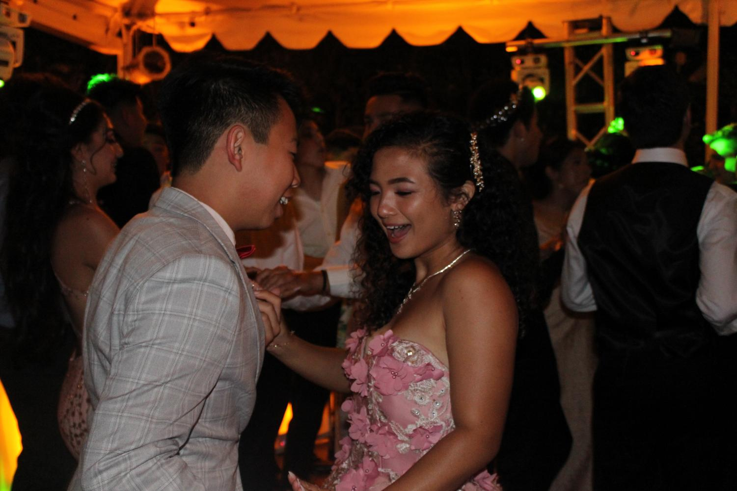 Junior+Alan+Ly+and+senior+Ceejay+Posis+dance+together+on+May+18.
