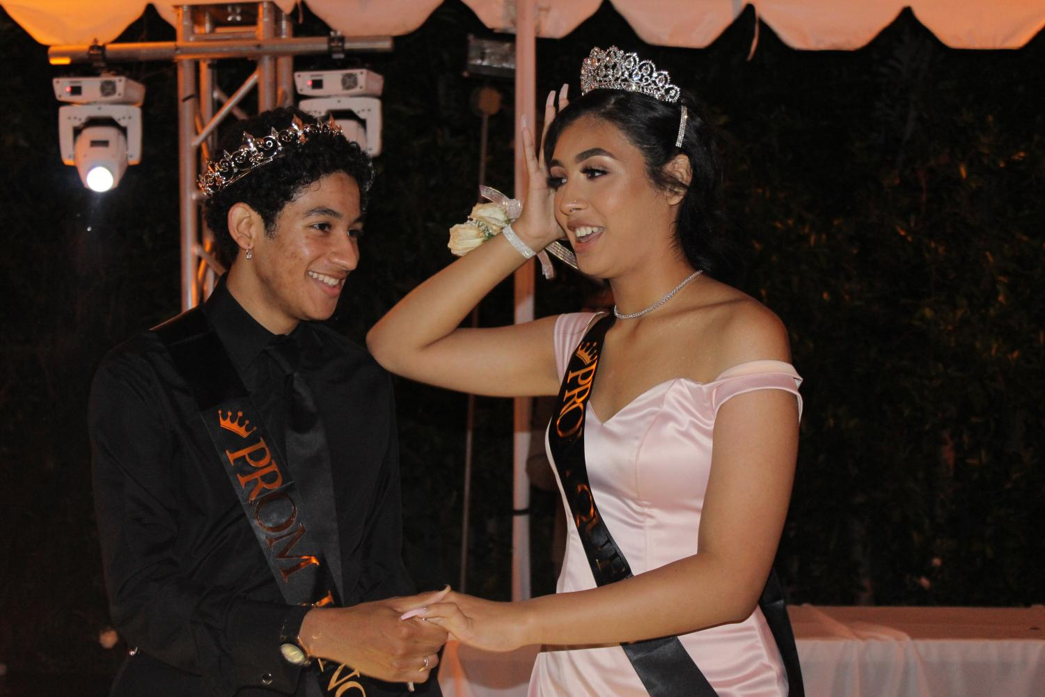 Seniors+Andres+Perkins+and+Briana+Ayala+start+to+dance+together+after+being+crowned+Prom+King+and+Queen.