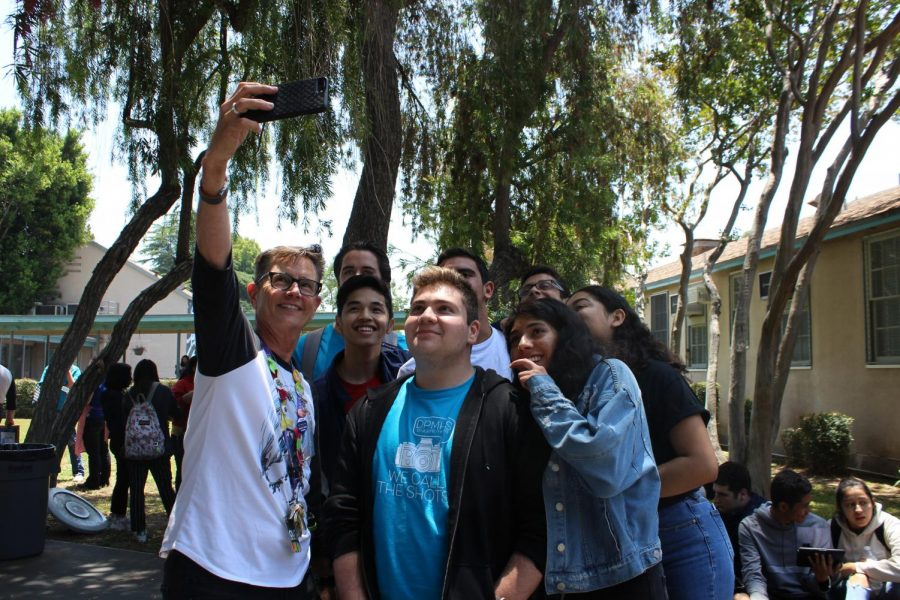 Seniors take a selfie with Principal Deb Smith during lunch today.