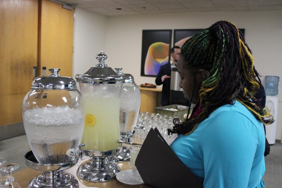Sophomore Sydnee Blueford gets a cup of lemonade during the Holocaust Remembrance Event in Sacramento.