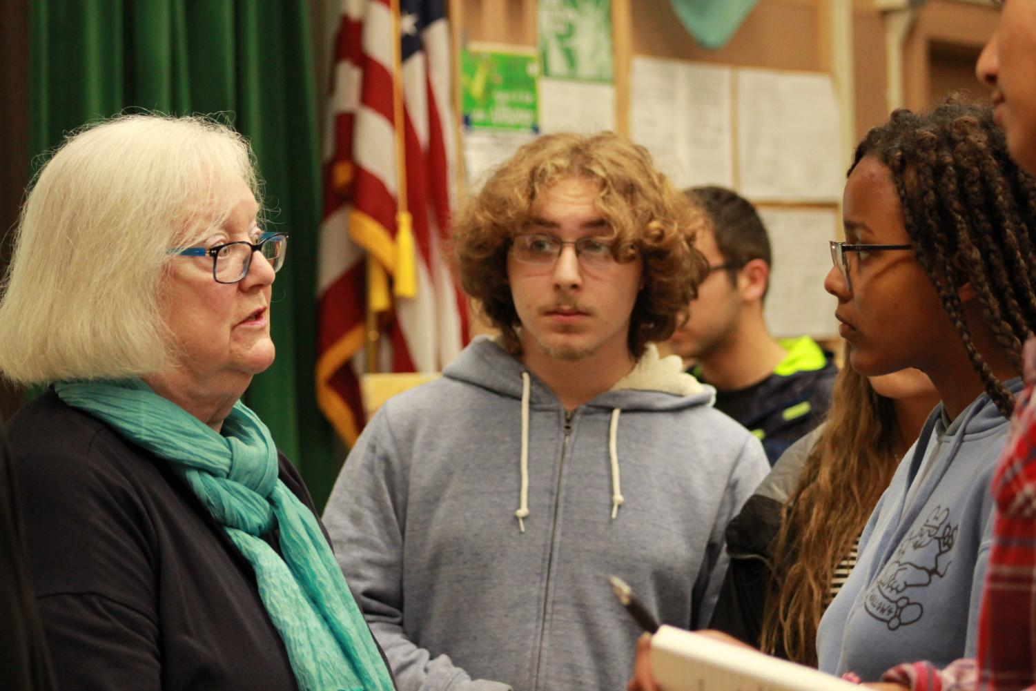Sophomores+Francisco+Weltman+and+Miko+Martinez+speak+with++Holocaust+survivor+Louise+Lawrence-Israels+on+May+9.