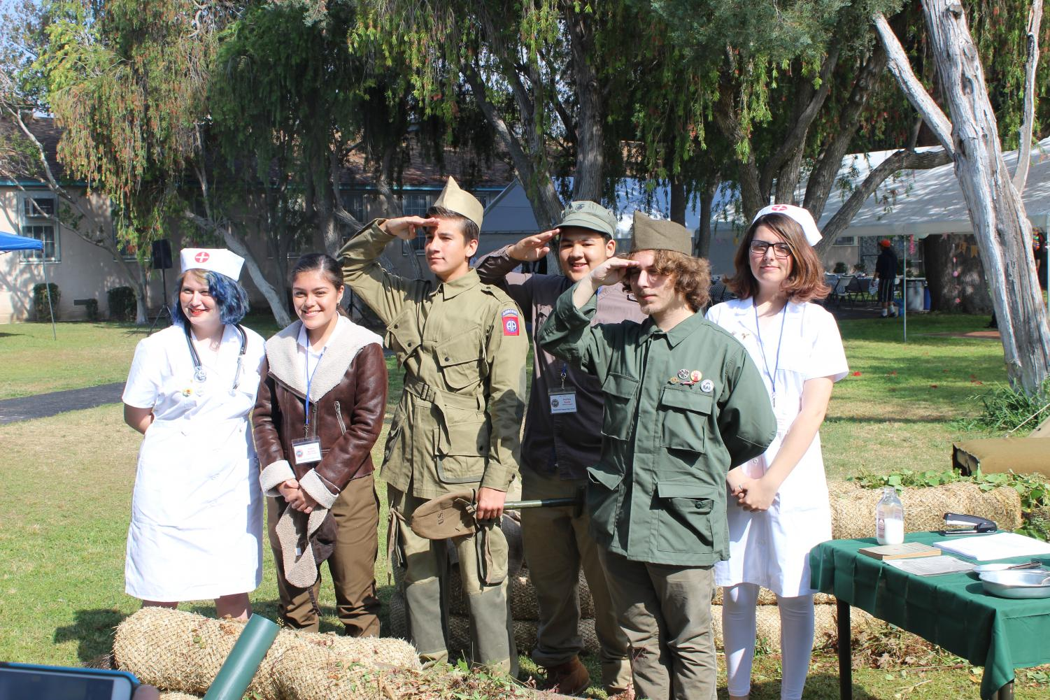 Sophomores+Adrienne+Bangert%2C+Valery+Barrera%2C+August+Defore%2C+Harlow+Frank%2C+Fransico+Weltman+and+Stephanie+Pynes+dressed+up+as+WWII+nurses+and+soldiers+during+Pearl+Con.+They+are+in+history+teacher+Francisco+Ortega%27s+AP+World+History+class.