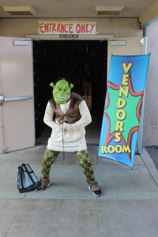Junior+Logan+Townsend+cosplays+as+Shrek+during+the+fourth+annual+Pearl+Con.%0A%0A