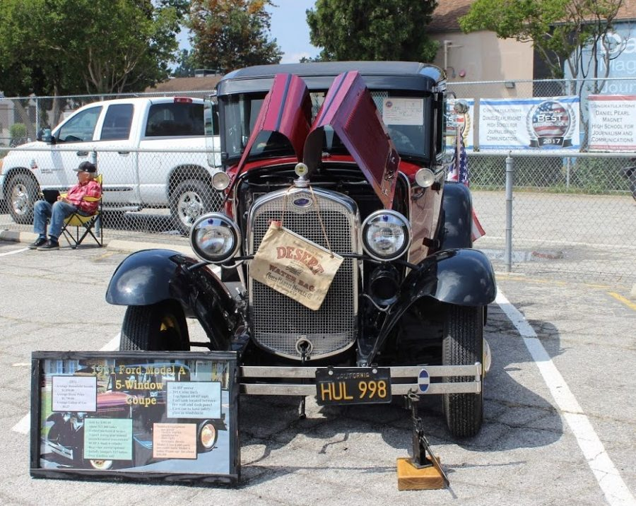 During the fourth Pearl Con volunteers brought in classic cars to put on display. One of the many included was the 1931 Ford Model A 5 Window Coupe.