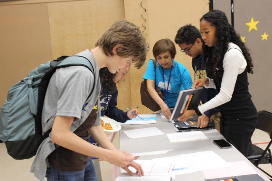 Students picked up their yearbooks today at distribution during lunch.
