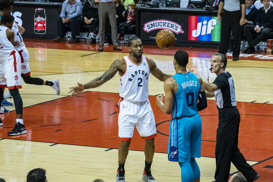 Kawhi Leonard of the Toronto Raptors confronts Charlotte Hornets' Miles Bridges during a game on March 25.