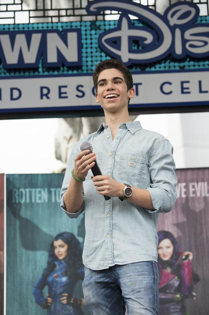 Cameron Boyce celebrates the announcement of the