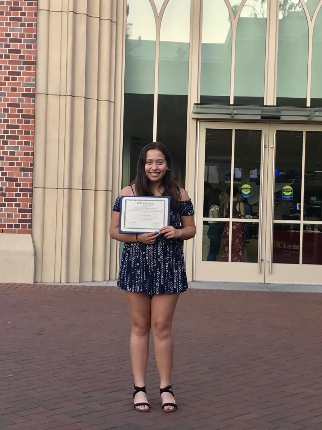 The+Pearl+Post+Managing+Editor+Itzel+Luna+holds+her+completion+certificate++outside+of+the+University+of+Southern+California+Annenberg+building+during+graduation+of+the+Annenberg+Youth+Academy+on+July+12.+