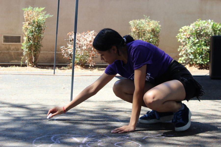 Senior Alyanna Ahorro draws some chalk art during the first Fiesta Friday of the year.