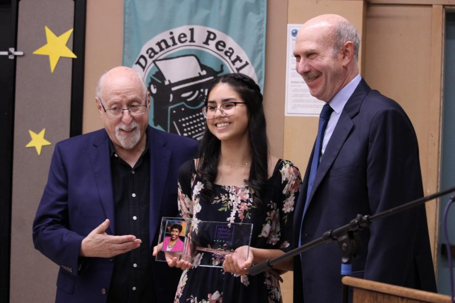 News Literacy Project board member Walt Mossberg, staff writer Valeria Luquin and Alan Miller founder and CEO of News Literacy Project smile to take a picture with the Gwen Ifill Student of the Year Award that Luquin received on Sept. 17.