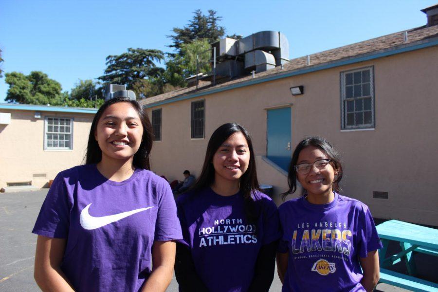 Seniors Keona Paniagua, Kimberly de Díos and Keona Paniagua represent the class of 2020 by wearing purple on Sept. 13.
