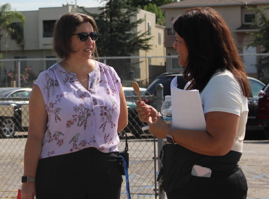 Magnet Coordinator Leah Pevar and resource teacher Jennifer Walker discuss the fire drill during the event during second period on Sept. 5.