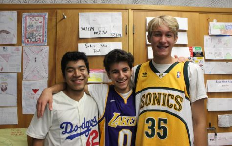 Seniors Ivan Moreno, Rami Chaar, and Cuyler Huffman pose in their sports' jerseys for DPMHS's Jersey Day on Sept. 27.