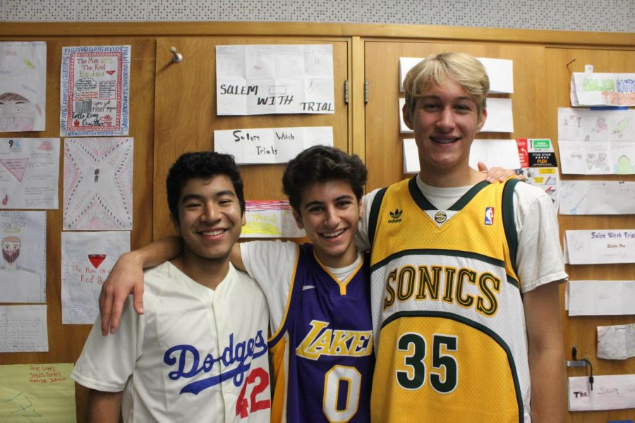 Seniors+Ivan+Moreno%2C+Rami+Chaar%2C+and+Cuyler+Huffman+pose+in+their+sports%27+jerseys+for+DPMHS%27s+Jersey+Day+on+Sept.+27.+%0A