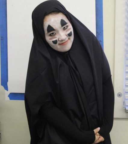 Math teacher Lori Seo dresses up as No-Face for Halloween on Oct. 31.