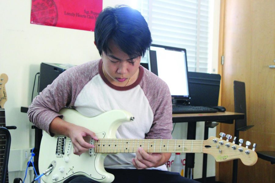 Senior Alan Ly practices his guitar for World Music Day during lunch on Oct. 17.