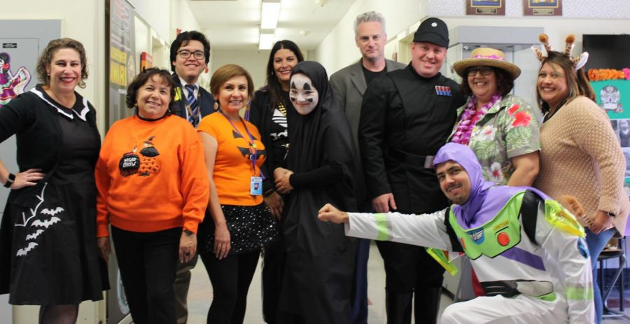 Teachers and staff take a Halloween  group photo on Oct. 31.