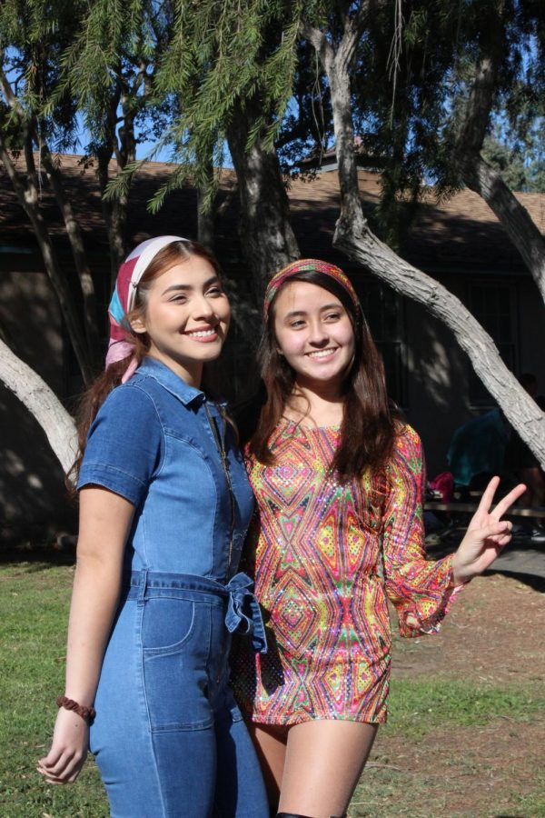 Seniors Aimee Guzman and Karen Ticas smile as they take a picture together on Oct. 31.
