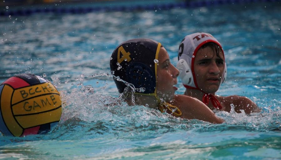 Freshman number four Ryan Nevsky passes ball to teammate during a Birmingham Community Charter Boys Water polo game against Taft Charter High School on Oct. 16.