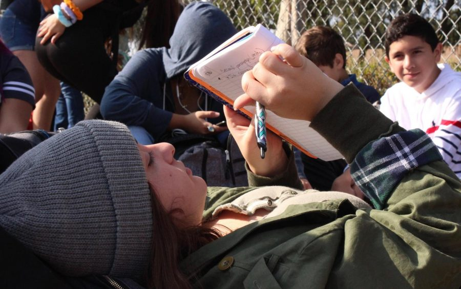 Sophomore Jessica Melkonyan finishes work for her English class during the earthquake drill on Oct. 17.