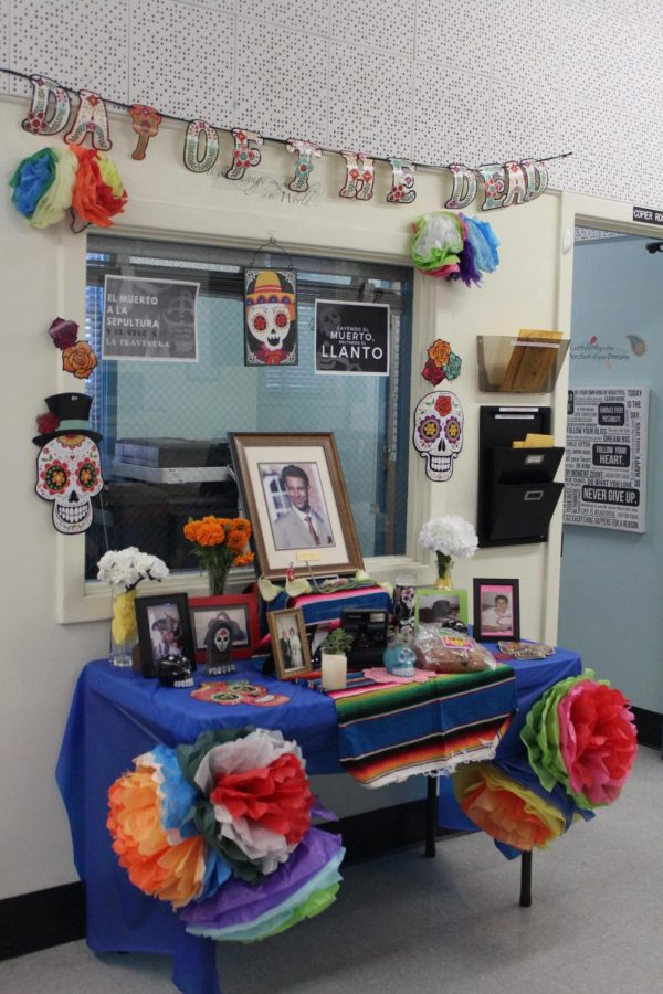 Office staff decorates an alter for late journalist Daniel Pearl, to celebrate his life during the Dia De Los Muertos event on Nov. 1.