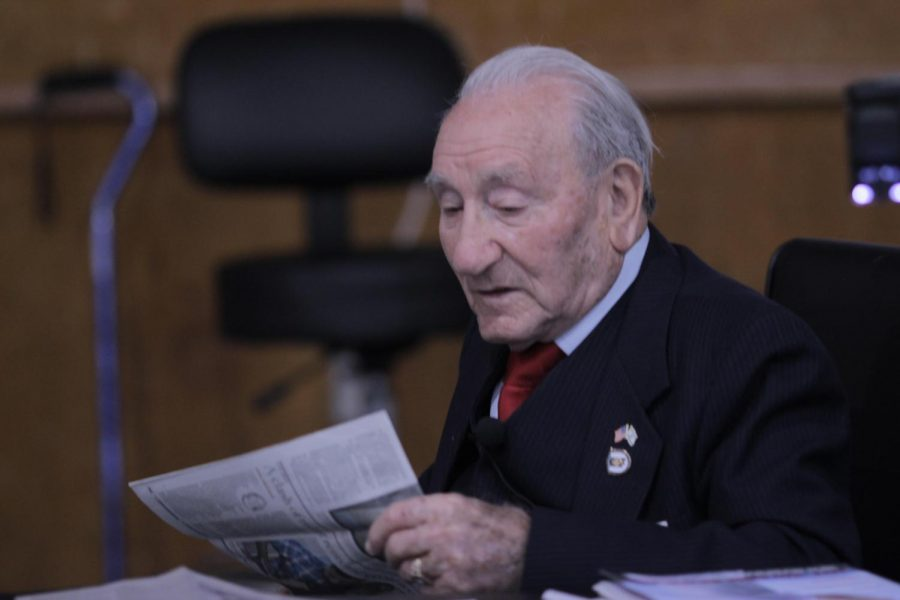 Holocaust survivor Joseph Alexander gives a personal account of his life during the Holocaust. He examines a newspaper with the audience in which he was featured in on Nov.14.